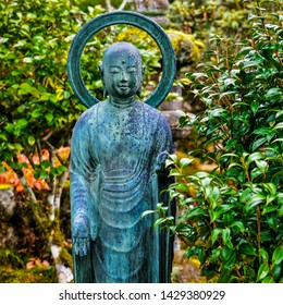 Kyoto, Japan - December 12, 2016: Jizo bosatsu (bodhisattva) bronze statue in the garden of Jikkoin Buddhist temple in Ohara mountain area