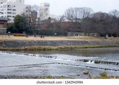 Kyoto, Japan - December 15, 2013: Kamogawa river - main river of Kyoto city