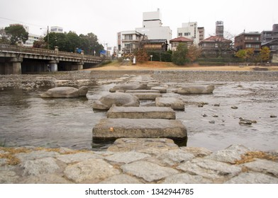 Kyoto, Japan - December 15, 2013: Stepping stones crossing Kamogawa river - main river of Kyoto city