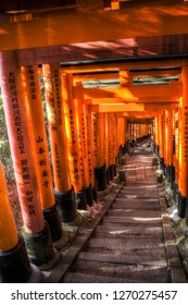 Kyoto, Japan - December 17. 2017: HDR image of a torii path (Senbon torii) at the Fushimi Inari-taisha, connecting the inner and outer shrines in Kyoto, Japan.
