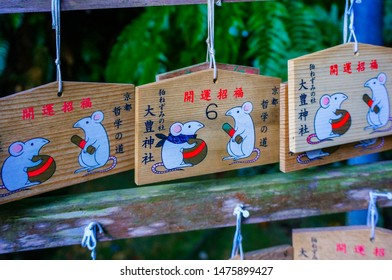 Kyoto, Japan - December 22, 2013: Ema votive tablets with cute little mice at Otoyo-jinja shinto shrine