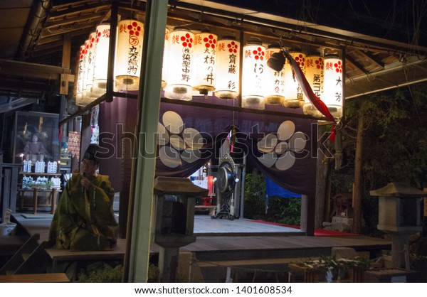 Kyoto, Japan - December 31, 2013: New Year gathering and ceremony at a small local shrine in the north of Kyoto