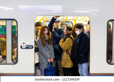 Kyoto, Japan - December 5, 2017. Passengers standing on train at metro station in Kyoto, Japan. Rail transport in Japan is a major means of passenger transport.