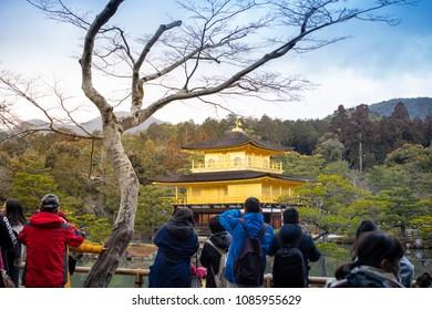Kyoto, Japan - February 10, 2017 : People traveling at Kinkakuji Temple.