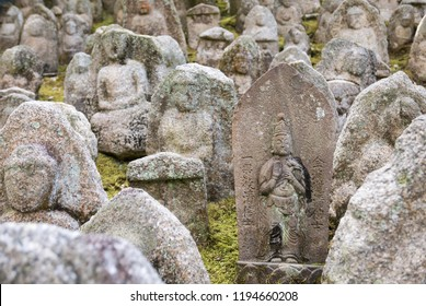 KYOTO, JAPAN - FEBRUARY 19, 2017 - The Thousand Stone Buddha garden at Kiyomizu-dera Temple contains many statues of the Buddhist deity Jizo, the patron deity of deceased children in Japanese culture.