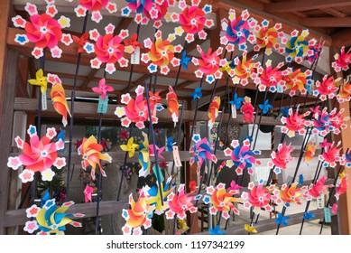 KYOTO, JAPAN - FEBRUARY 19, 2017 - Pinwheel offerings to the Buddhist deity Jizo at Ryozen Kannon. Jizo is the patron deity of deceased children in Japanese culture.
