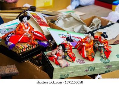 Kyoto, Japan - February 25, 2017: traditional Japanese hina dolls on sale at Tenjin flee market at Kitano Tenmangu Shrine