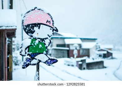 KYOTO, JAPAN - FEBRUARY 7, 2016: Typical street sign in Japan where cartoon drawings of a Japanese boy and girl are used to warn drivers of Japanese elementary schoolkids crossing the road.