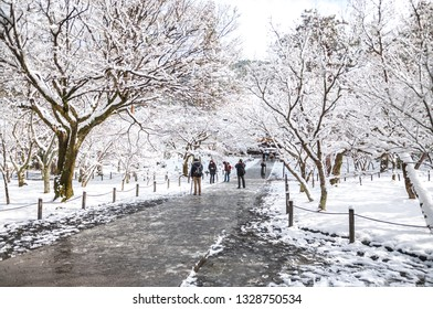 KYOTO, JAPAN - JANUARY 15, 2017 : Photo of local visitors and international tourists sightseeing and taking photos of the beautiful winter landscape seen in Kyoto City's Nanzenji Temple in Japan.