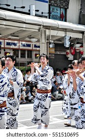 Kyoto, Japan - July 17, 2011: Unidentified Japanese men performing in the parade in Gion Festival, Kyoto, Japan
