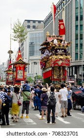 KYOTO, JAPAN - JULY 17, 2017 People  pulling a huge float celebrating  Gion Matsuri  the most famous festivals in Kyoto.