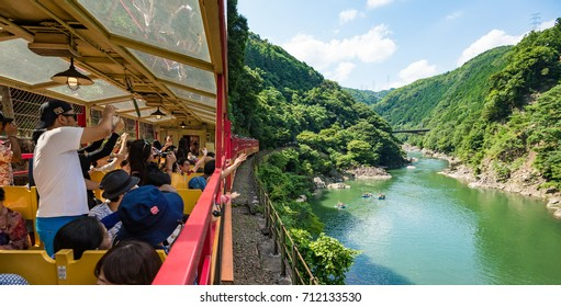 KYOTO, JAPAN - JULY 18, 2016: Sagano scenic railway, Kyoto. This line passes a gorge offering a scenic view along the Hozu river.