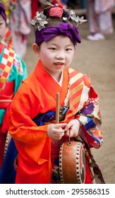 KYOTO, JAPAN - JULY 7: little Japanese girl in geisha makeup and a kimono at Shiramine Jingu shrine during Tanabata Festival celebrations in Kyoto on July 7th 2015.