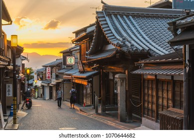 KYOTO, JAPAN - JUNE 18 2017: Tourists walk on a street leading to Kiyomizu Temple on June 18 2017. Kiyomizu is a famous temple in Kyoto built in year 778.