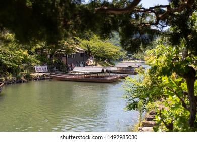 Kyoto, Japan - June 25, 2019: Katsura river and boats