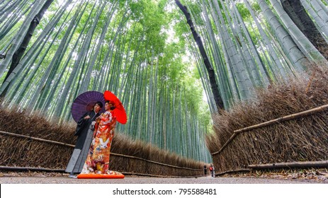 KYOTO, JAPAN- JUNE 9, 2015: Unidentified couple takes wedding photos in the famous Arashiyama bamboo grove track in Kyoto, Japan