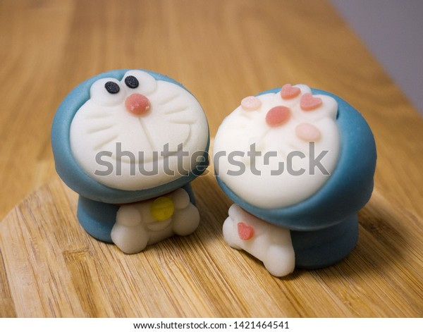 Kyoto, Japan - March 11, 2019: Traditional Japanese wagashi sweets in the shape of Doraemon - robot cat without ears and a famous character of kids anime series