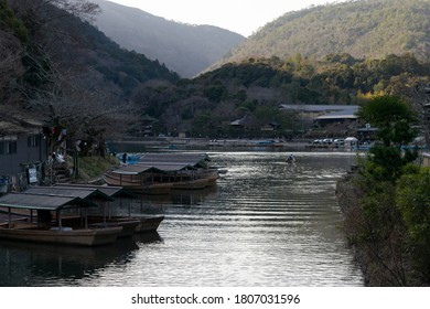 Kyoto / Japan - March 12, 2020: Empty boats in Katsura river from Togetsukyo Bridge in Kyoto Japan