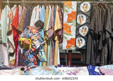 Kyoto, Japan - March 2016: Lady selecting Kimono from colourful collection in a Kimono rental shop on Matsubara street in Kyoto, Japan