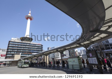 KYOTO, JAPAN - MARCH 21: Kyoto Tower and Kyoto Tower Hotel viewed from Kyoto station bus terminal on 21st Mar 2012. The tower has a 100m high observation deck with 360 degree views of the city.