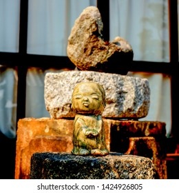 Kyoto, Japan - March 24, 2014: small ceramic sculpture of Jizo bosatsu in a small temple in the north of Kyoto