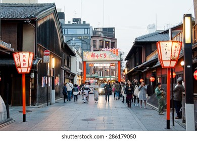 KYOTO, JAPAN - March 24, 2014:  Many tourists walk in Gion area on March 24, 2014 in Kyoto, Japan. Old Kyoto is a UNESCO World Heritage site and was visited by almost 1 million foreign tourists.