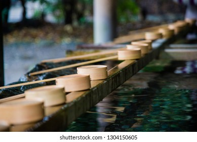 Kyoto, Japan - March 25 2016: Water ladles and wooden dippers used for a ceremonial purification in entrance of the shrine