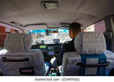 Kyoto, Japan - March 28, 2015 : A dedicated taxi driver is doing his job