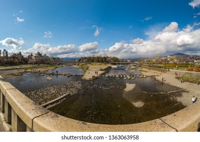 KYOTO, JAPAN - MARCH 31, 2019 : Panoramic photo of Kamo River at the point where two rivers merge into one, taken from the Kamo Ohashi Bridge near Demachiyanagi Station.