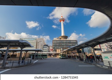 Kyoto / Japan - March 5 2015: Curve of roofing bus station with clouds blue sky, Kyoto tower opposite kyoto station, Transportation in kyoto city located kansai region of japan, japan cityscape