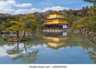 Kyoto / Japan - March 6 2015: Buddhist temple in Kyoto, Golden Pavilion Temple most of popular attraction Clear sky and sunshine seeing pavilion reflect in pond, magnificent japanese garden green view