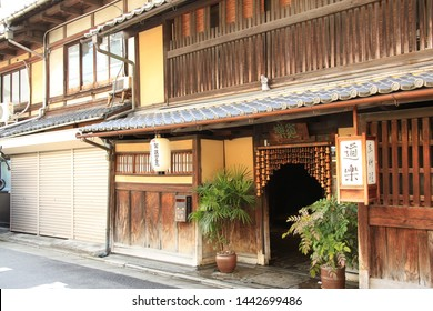 Kyoto Japan - March 8, 2014. Traditional Japanese housing at streets in Kyoto station area. Shoki-san is put on roof as guardian deity who drive away evil spirits.