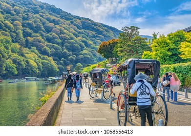 KYOTO, JAPAN - MAY 05, 2013 : Unidentified people and rickshaw near Katsura river, Arashiyama, tourist spot, Kyoto, Japan
