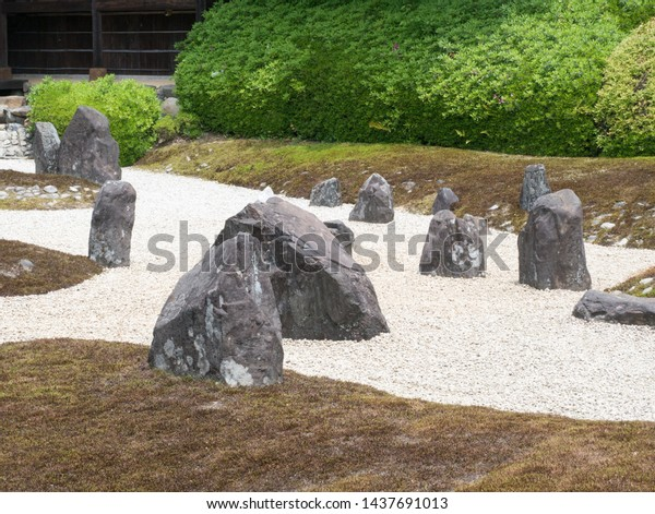 Kyoto, Japan - May 10, 2019: Japanese Stone garden of a quiet Komyoin temple designed by famous landscape historian and designer Shigemori Mirei