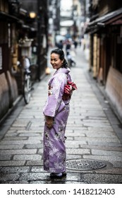 Kyoto, Japan - May 14 2019: Young lady in a kimono in the streets of Kyoto on a warm spring day in Japan