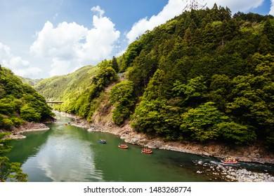 Kyoto, Japan - May 16 2019: Japanese children on a rafting trip along the Katsura River near Kyoto, Japan
