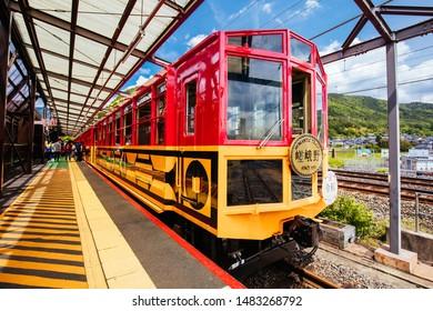 Kyoto, Japan - May 16 2019: The world famous Sagano Romantic Train running along the Katsura River near Kyoto, Japan