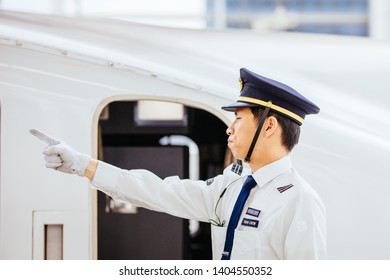 Kyoto, Japan - MAY 18, 2019: Perspective view of Japanese Shinkansen driver during their routine at a train stop  on an N700A bullet train