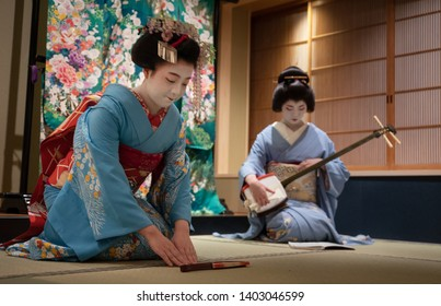 Kyoto, Japan - May 19, 2019: Maiko bows at the end of traditional performance in small Japanese inn