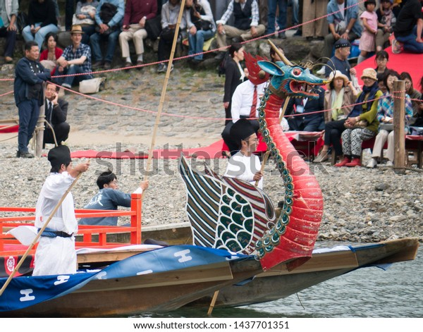 Kyoto, Japan - May 19, 2019: colorful dragon boats of Mifune festival on Katsuragawa river in Arashiyama scenic area