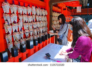 Kyoto, Japan - May 2, 2015 : Japanese wood amulets at Fushimi Inari shrine in Kyoto, Japan.