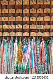 Kyoto, Japan - May 2016: Wall of Emas. Emas are small wooden plaques displaying a picture or painting. People commonly write a wish on an ema and hang it in a designated place within a shrine.