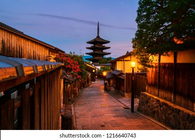 Kyoto, Japan. A night view of To-ji temple and a row of old japanese shops and houses in Kyoto, Japan.