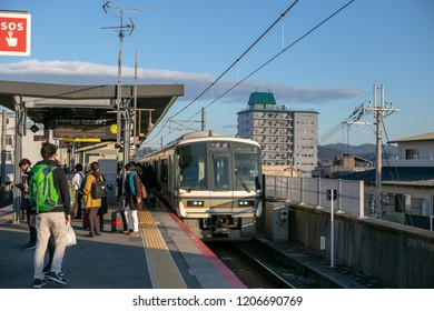 Kyoto, Japan - Nov 16, 2017 : Many peopel and tourists waiting train at Emmachi station on Nov 16, 2017 at Kyoto, Japan.