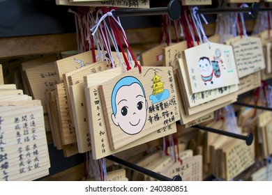 KYOTO, JAPAN - NOV 17: Ema prayer plaques with wishes or prayers of Shinto worshippers at Kinkaku-ji, Golden Pavilion, on November 17, 2014, in Kyoto, Japan. Ema boards are a popular Shinto tradition.