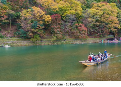 Kyoto, Japan - Nov 19, 2017: Arashiyama and Katsura river is the famous destination for tourist in autumn of japan. Many tourists sightseeing by japanese style boat