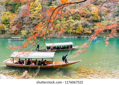 Kyoto, Japan - Nov 25, 2017: Arashiyama and Katsura river is the famous destination for tourist in autumn of japan. Many tourists sightseeing by japanese style boat