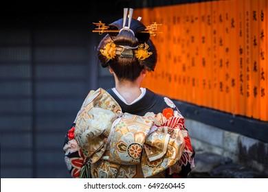 KYOTO, JAPAN - NOVEMBER 11, 2016: Woman wearing traditional japanese kimono walk on the street of Gion, Kyoto old town, Japan. Kimono is a Japanese traditional garment.