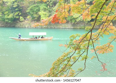 KYOTO, JAPAN - November 11 :Autumn in Katsura-gawa River ,on November 11,2018 in Arashiyama,Japan.There's well known, central landmark.Peasure boats that are available for rent on the river.