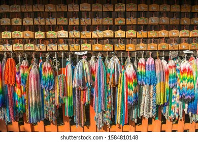Kyoto, Japan - november 12, 2019: Senbazuru and Ema at the Fushimi Inari Shrine. Senbazuru - group of origami paper cranes held together by a string while Ema wooden plates with wish for good luck